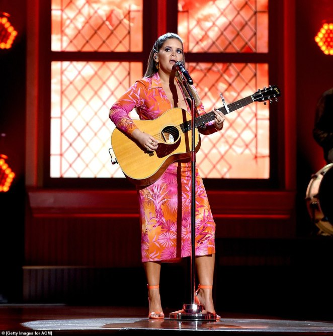 Tropical vibes:Maren Morris, who welcomed her first child, a son, with husband Ryan Hurd, 33, slipped her incredible post-baby body into a bright, tropically patterned dress as she graced the stage