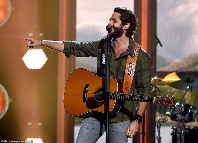Owning the stage:Thomas Rhett performing during theEntertainer Of The Year medley