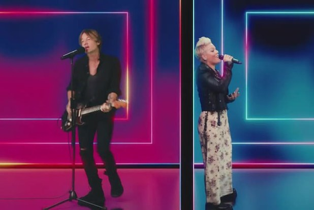 'I spend all my money drinking myself, yes / this time, just sitting here staring at my phone / and I kept second guessing, where did I go wrong?'  Entertainers sang during the song's world television premiere