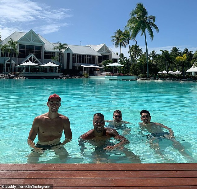 Buddy Franklin (second left with Swans teammates) is lapping up the amenities at the Sheraton Grand Mirage Resort