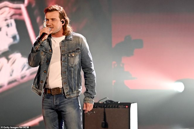 Whiskey Glasses:Morgan Wallen rocked a denim-on-denim ensemble and a mullet, while rocking out to his bar-friendly song Whiskey Glasses