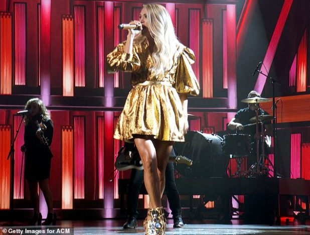 Stay Gold: She performed brilliantly in a sparkling mini mini dress with Believe Sleeves, as she sang in a matching gold microphone