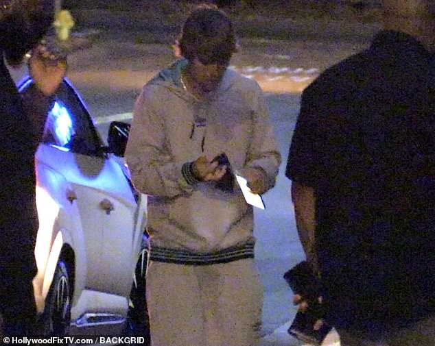 Cozy display: Justin Bieberkept it cozy in sweats Wednesday, as wife Hailey showed off her tight tummy in a white crop top, while they grabbed dinner at BOA Steakhouse in West Hollywood
