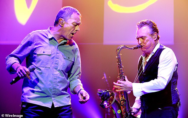 Shocking: Lead singer Duncan Campbell (left) suffered a stroke in August, which he is still recovering from. Also pictured: Brian Travers on the saxophone