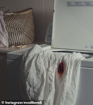 One shot shows a bed sheet hanging out of a washing machine with a circular red blood stain (pictured)