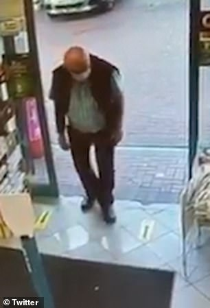 The man walks into the store and scans the area