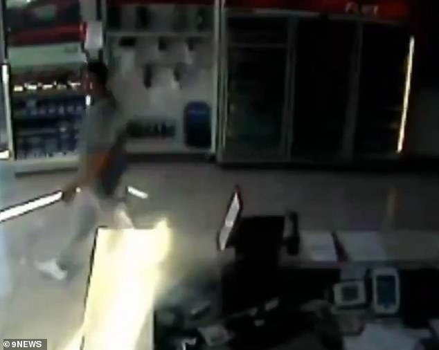 CCTV captures the moment Hawi casually walks past the reception of the Sydney gym just seconds before his assassination