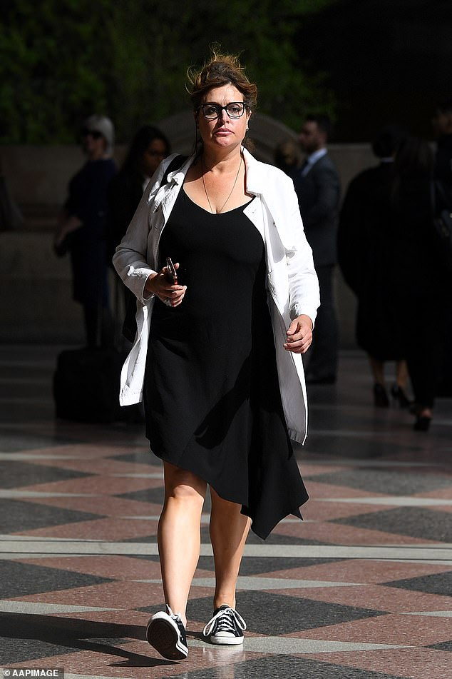 Court: Tziporah Malkah (pictured) wore a simple black dress, a white jacket and black and white sneakers as she arrived to Sydney's Downing Centre on Thursday