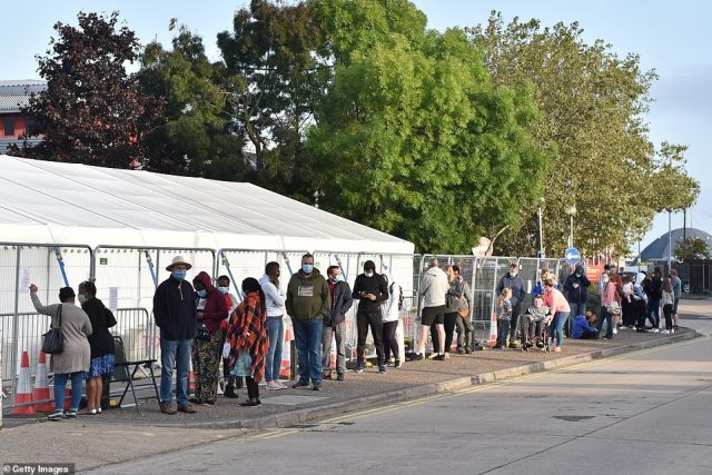 A queue is pictured outside a swab-testing site in Southend-on-Sea, Essex, this morning