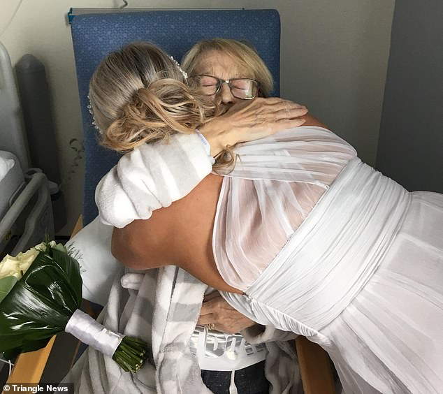 This is the heart-breaking moment bride Nicole Lind, dressed all in white, surprised her terminally ill mother Elizabeth Bridgewater by arranging a wedding in just five days - having sworn never to get married