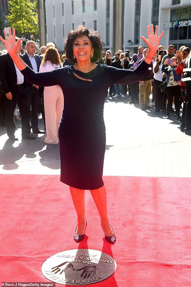 A navy blue dress worn by Dame Shirley Bassey to the unveiling of her handprints in Wembley Park's iconic 'Square of Fame' in September last year sold for £1,125.