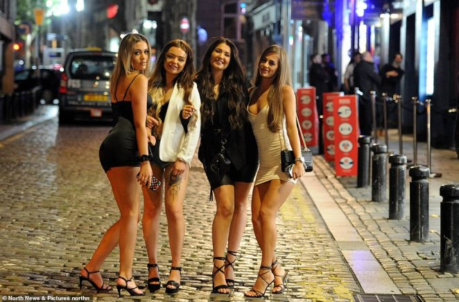 A group of revellers enjoy a night out in Newcastle city tonight, the last evening before lockdown measures are brought in