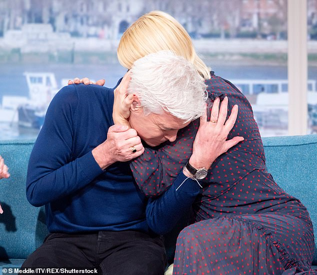 A friend in need:Following his revelation, the presenter took his place on the This Morning sofa besides co-host Holly, who has supported him, to further pour his heart out (pictured)