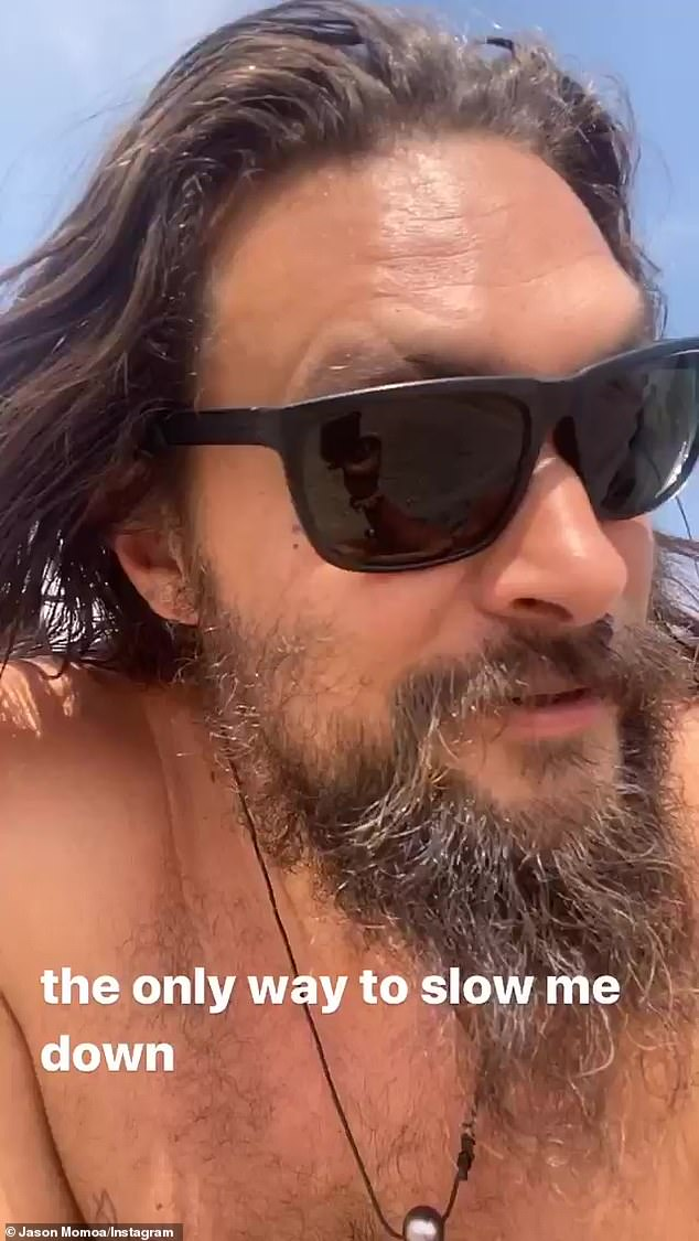Bare Torso: Momoa started her naked torso video wearing a pair of black sunglasses, black and white striped pants and flip flops