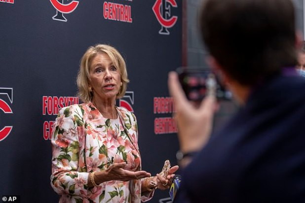 US Secretary of Education Betsy DeVos (pictured) answers questions after a visit to Forsyth Central High School in Cumming, Georgia.
