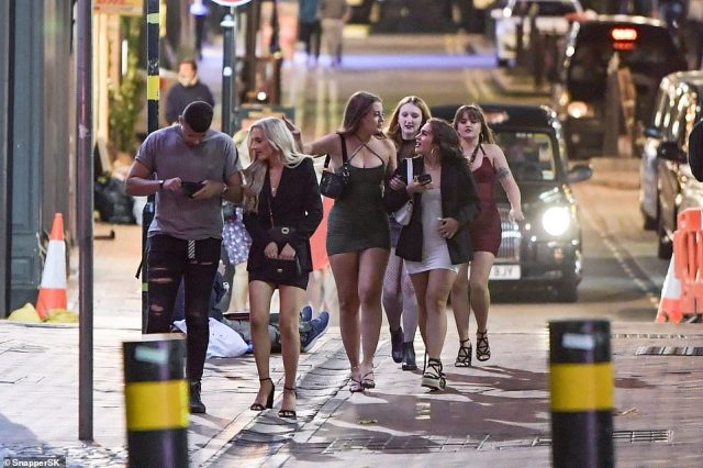 Pictured: Partygoers hit the streets of Birmingham last night after the city was recently placed under a tougher lockdown