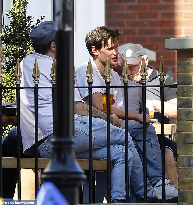 Comfy: Soaking up the sun during the outing, Matt kept things casual as he paired his top with light-wash jeans