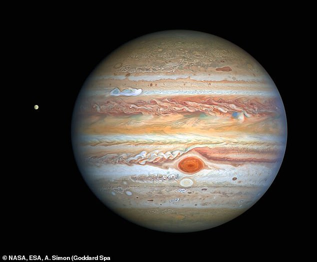 Image of Jupiter taken by Hubble has captured the formation of an almighty storm in the planet's northern hemisphere. it also shows Europa and the legendary Great Red Spot which is a strm bigger than Earth which has been raging for more than 350 years