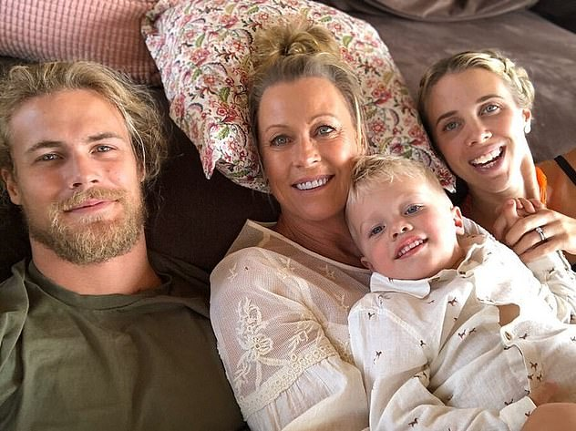 Lisa Curry is pictured with her son Jett (left), surviving daughter Morgan (right) and her grandson Flynn
