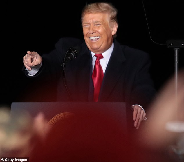 Donald Trump (pictured speaking during a rally in Wisconsin yesterday) offered Julian Assange a 'win-win' deal to avoid extradition if he disclosed the source behind leaked Democratic party emails, a court heard today