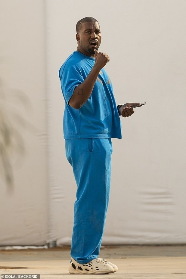 Regarding behavior: The rapper is seen performing youth services at the Yeezy Christian Academy in Calabas on Wednesday