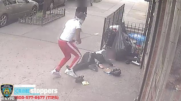 The second attacker, who was dressed in a white tee and red sweatpants, repeatedly beat the teen with a wooden plank before he fell to the ground