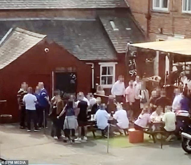 Officers visited the Old Crown in Wigston, Leicestershire yesterday after a local resident called them to claim people were not following coronavirus guidelines. Pictured: The wake