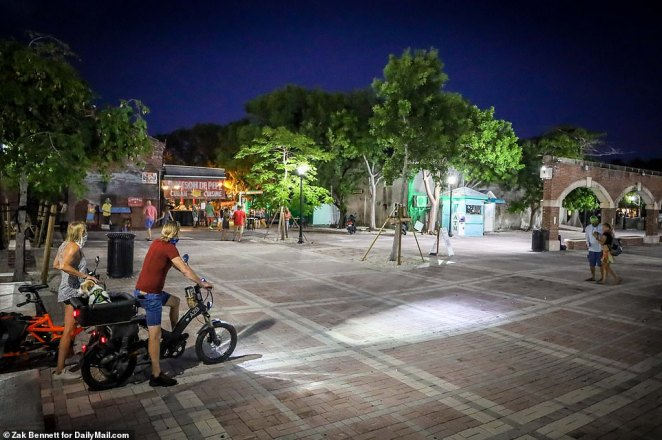Mallory Square is seen rather empty just after sunset in Key West, as over 2,000 people tested positive and 152 died on Wednesday across Florida