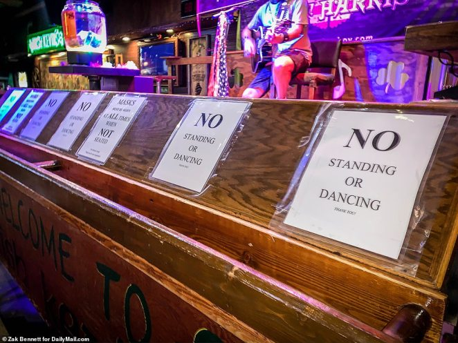 Signs tell patrons the COVID-19 rules at Irish Kevin's Bar And Restaurant in Key West. Some local bars hadn't reopened since Florida banned alcohol consumption at bars on June 26 due to the spread of COVID-19