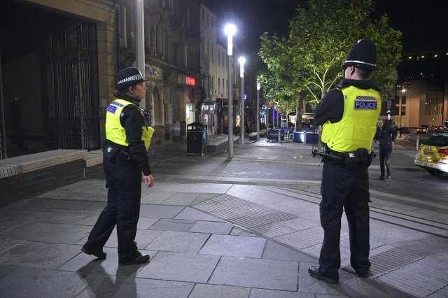 Police officers survey the normally heaving Big Market area of Newcastle. Pubs are closing at 10pm due to a new localised lockdown to battle the pandemic