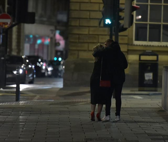 A couple head home in Newcastle after the bars and clubs closed at 10pm this evening as part of a new local curfew