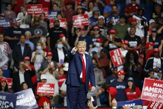 Pictured: President Donald Trump speaks during a campaign rally at the BOK Center in Tulsa, Oklahoma, where few people wore masks or social distanced