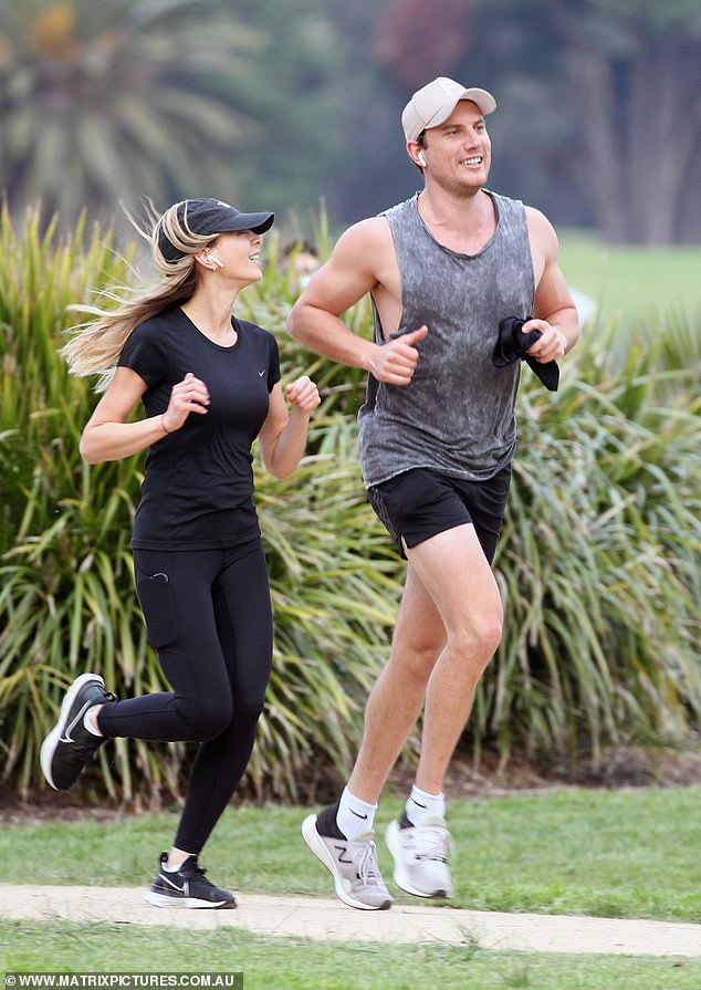 The man making her smile again! The brunette beauty, 35, was beaming as she jogged alongside her handsome new beau