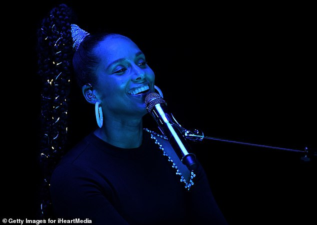 The blues: The first of the two-night event also featured a performance by Alicia Keys, who performed at a piano, soaked in a blue light