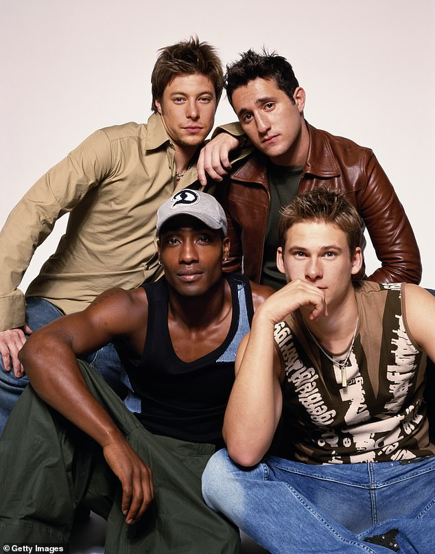 All Rise to Fame: He rose to fame in the early days of the Noughties as a member of Blue, alongside (LR) Duncan James, Simon Webbe and Lee Ryan. Photographed in 2001