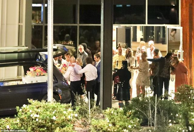 Tribute: A bagpiper played a stirring tune as Jaimi's white coffin, covered in pink and orange dahlias and baby's breath, was placed in the back of the hearse