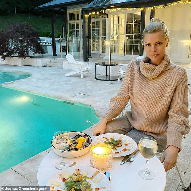 Romance: On Saturday, Sophie Monk (pictured) enjoyed a romantic date night at home with her beau, Joshua Gross