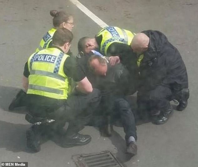 He went drinking after committing the crime and was spotted and pursued by a policeman who tackled and arrested him (pictured)