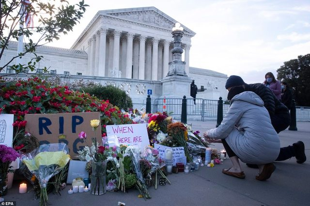 Flowers and tribute signs lined the sidewalk outside of the Supreme Court, where Ginsburg served for 27 years