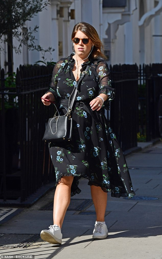 Making the most of the last days of sunshine, Beatrice sported a summer dress and oversized shades as she wondered the streets