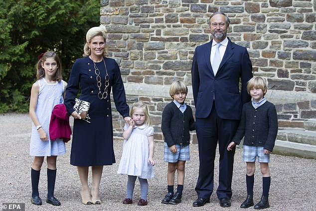 Count Christian and Countess Luisa de Lannoy with their children arrive for the baptism today