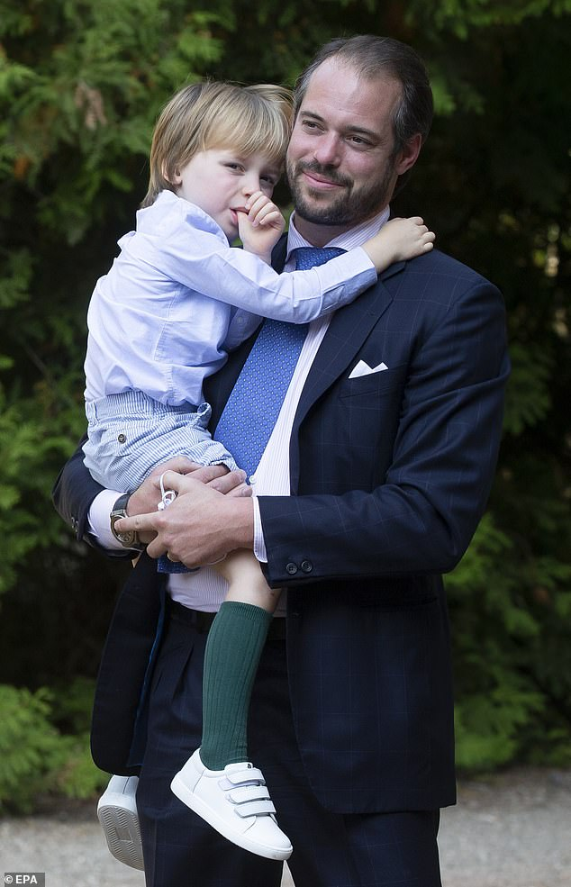 Prince Felix of Luxembourg and his son Prince Liam arrive for the baptism of Prince Charles today