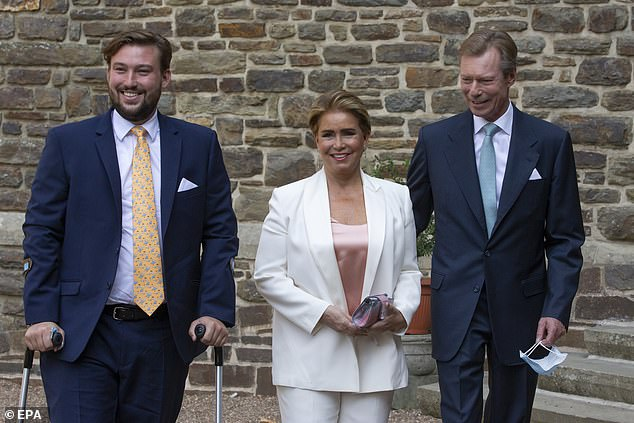 Prince Sebastien of Luxembourg, Grand Duchess Maria Teresa of Luxembourg and Grand Duke Henri of Luxembourg arrive for the baptism of Prince Charles of Luxembourg at the Benedictine Abbey of Saint-Maurice