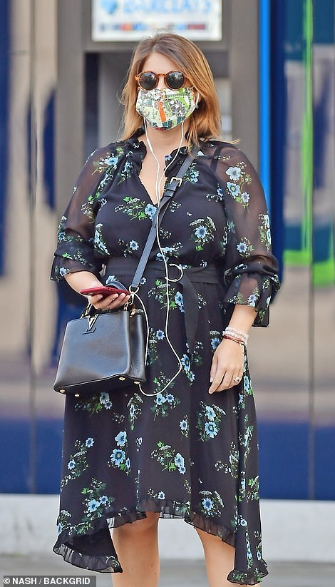 Clutching her iPhone, which is in a red case, the royal showed off her sartorial prowess by sporting a Louis Vuitton bag