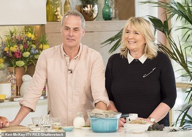 Cryptic: Fern Britton has suggested that it is 'easier to forgive your enemies than your friends' in a new online post, eight months after revealing she had split from her husband Paul Vickery (pictured together on This Morning in 2017)