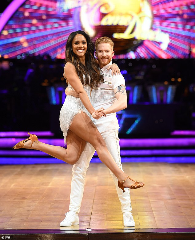 New rules: Neil's role may have been cut because this year's ­contest will feature fewer ­couples than usual (pictured with former dance partner Alex Scott on tour)