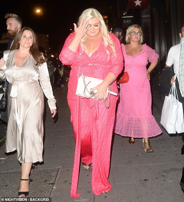 Night out:She put on a confident display as she stepped out with friends and appeared in high spirits after her meal