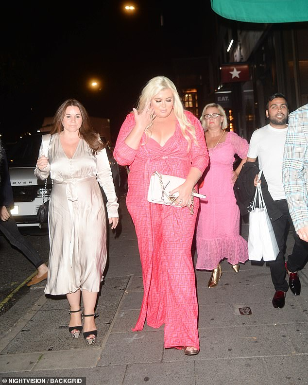 Glam!The TV personality wore her golden locks in long waves, while a generous serving of makeup ensured she stood out as she enjoyed her evening
