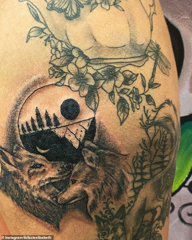 New ink:The brunette beauty proudly showed off her new design which was a black and white circle which shows a forest and mountain design alongside two wolves