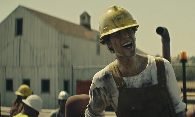 Sign of the times: Bieber stars in Colin Tilley-directed Holy video as a struggling oil miner fired and deported